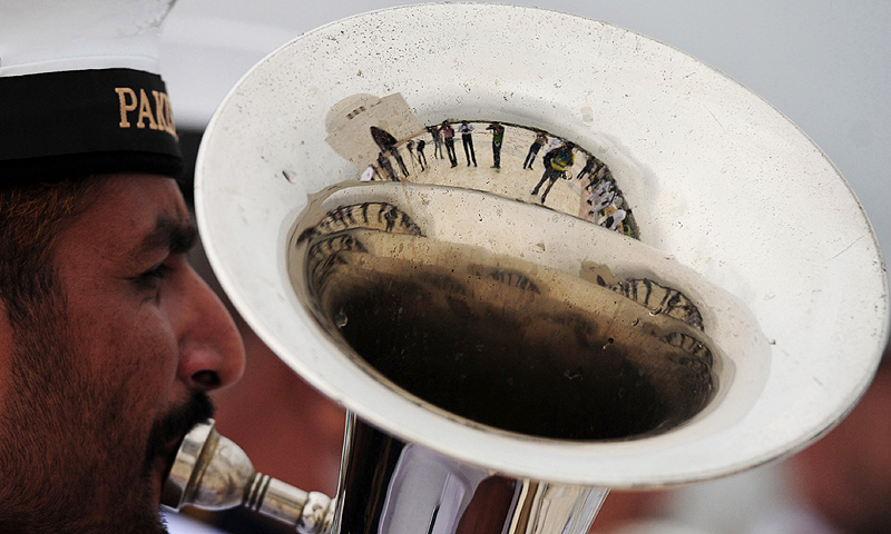 A Pakistani Naval band member plays a tuba at the mausoleum of the founder of Pakistan Muhammad Ali Jinnah, Karachi. -Photo by AFP