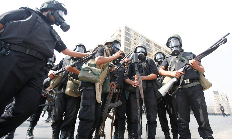 Riot police gather during clashes with protestors.
