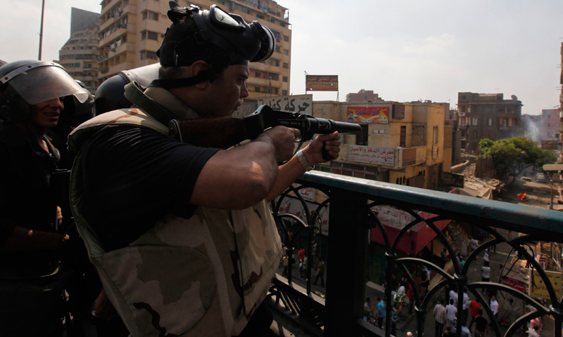 Riot police fire tear gas during clashes with members of the Muslim Brotherhood and supporters of deposed Egyptian President Mohamed Mursi, near Cairo University and Nahdet Misr Square are in Giza, south of Cairo.