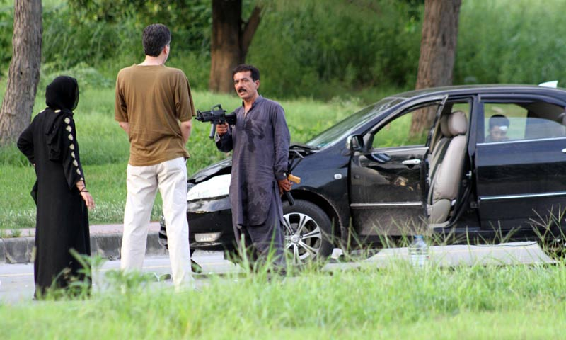 A senior police official negotiating with the gunman in Islamabad. -INP Photo
