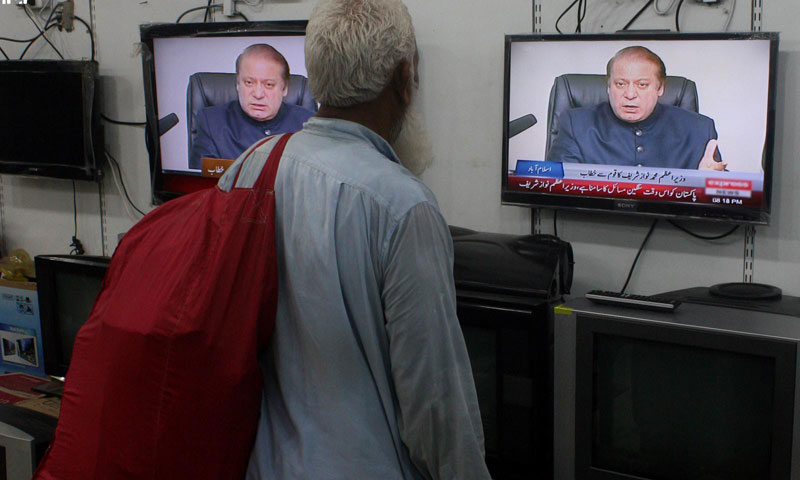An old man watches first televised official speech of Pakistani Prime Minister Nawaz Sharif on Monday. – PPI Photo