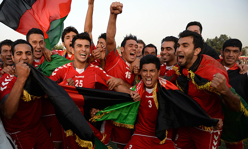 Afghan footballers celebrate their 3-0 win. -Photo by AFP