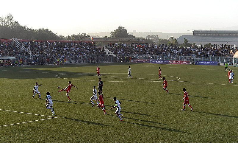Afghan (red) and Pakistani players seen in action. -Photo by AFP