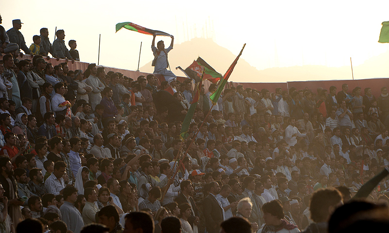 Afghan fans, who came out to support their team from all over the country, cheer for their team. -Photo by AFP
