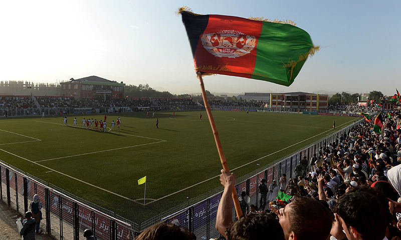 Afghan fans celebrate their team's victory against Pakistan. -Photo by AFP