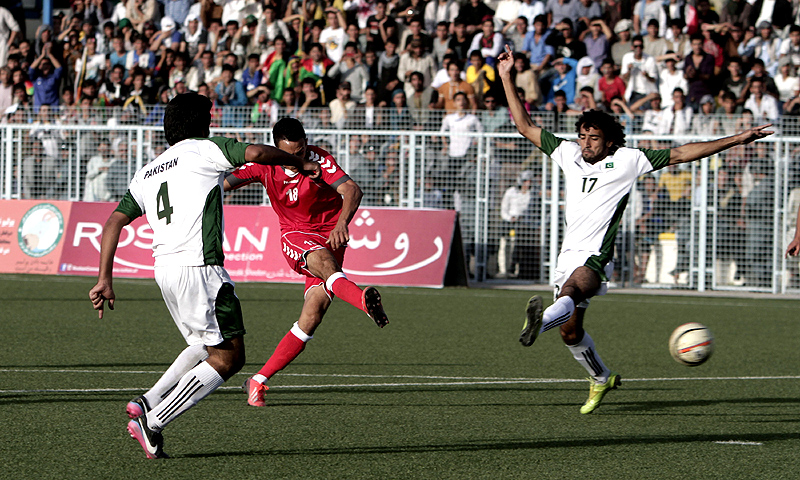 An Afghan player shoots towards goal. -Photo by AP