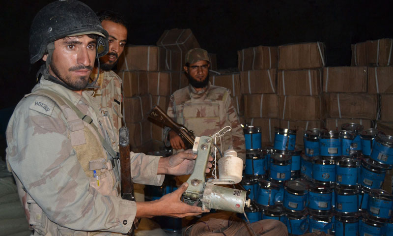 Pakistani paramilitary soldiers stand beside the seized bomb making material in Quetta on August 20, 2013. – AFP Photo