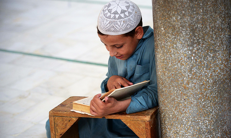 A student at the seminary near Gunj Gate of Peshawar. -Photo by AFP