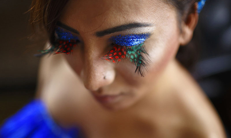 A Nepalese transgender is pictured while getting ready for a LGBT (lesbian, gay, bisexual, and transgender) pride parade to mark the Gaijatra Festival, also known as the festival of cows, in Kathmandu.—Photo by Reuters