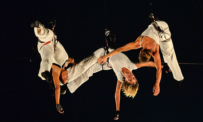 "Dancers from the Compagnie Retouramont perform ""Pyramid of Void"" while suspended in mid-air during a media preview of the Singapore Night Festival. The sixth edition of the Singapore Night Festival to be held over two weekends in August consist of an eclectic mix of aerial performances, art and light installations, roving acts and heritage-inspired programmes by local and international performers.—Photo by AFP"
