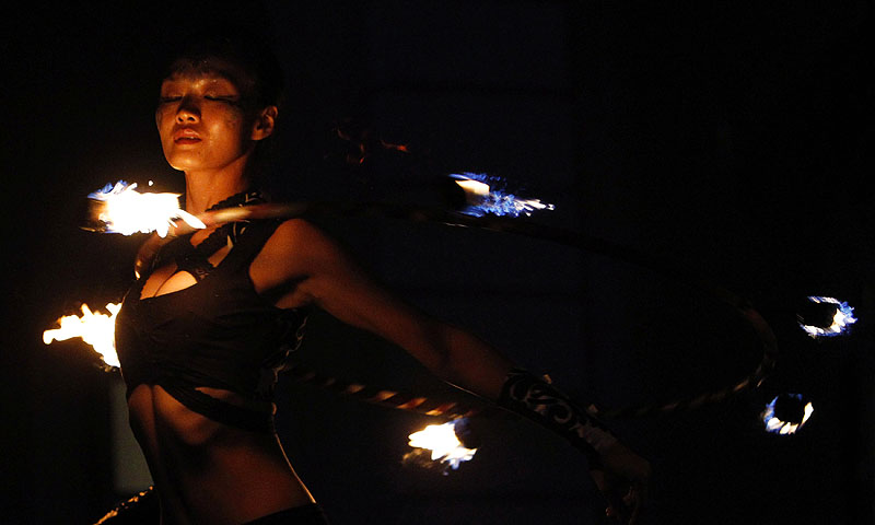 A member of the Starlight Alchemy: Redux performs during a media preview of the Singapore Night Festival.—Photo by Reuters