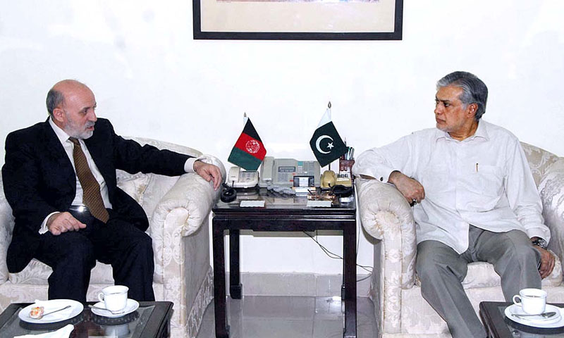 Federal Minister for Finance Ishaq Dar in a meeting with Afghan ambassador. — Photo by APP