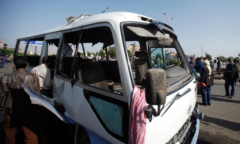 Forensic experts inspect a bus after a bomb attack in Sanaa August 25, 2013. — Photo by Reuters