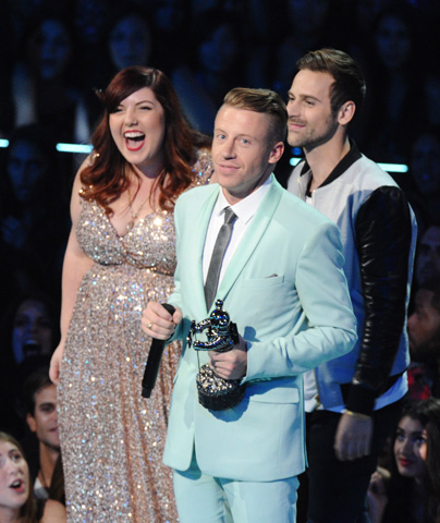 "Mary Lambert (left), Macklemore (center), and Ryan Lewis accept the award for best video with a social message for ""Same Love"". –Photo by AP"