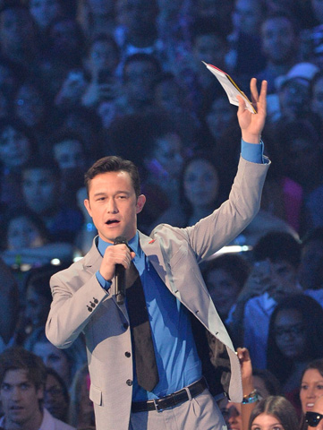 Joseph Gordon-Levitt speaks onstage. –Photo by AFP