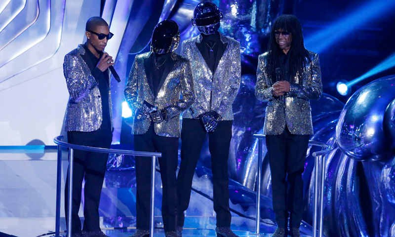 Daft Punk (centre), with Pharrell Williams (left) and Nile Rogers (right) stand on stage. –Photo by Reuters