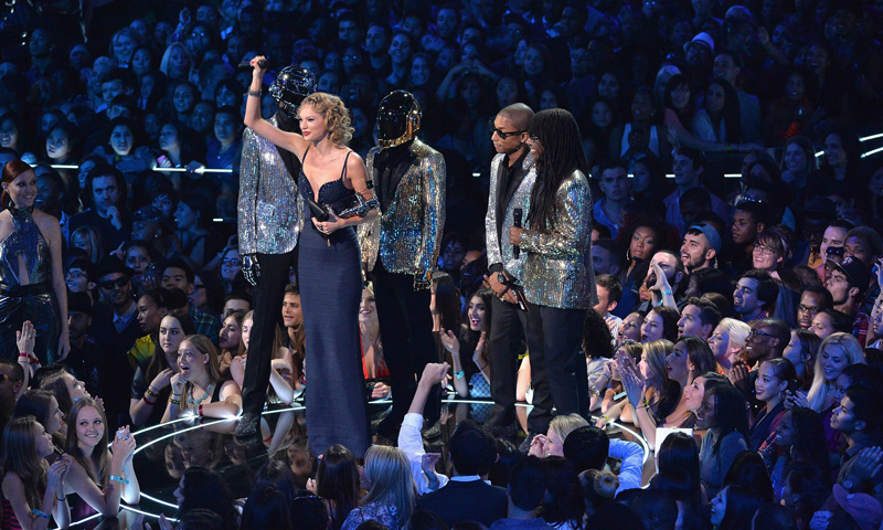 Taylor Swift, Daft Punk, Pharrell Williams and Nile Rodgers speak onstage.  –Photo by AFP