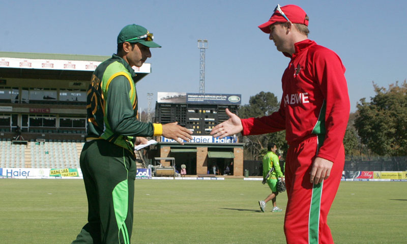 Zimbabwe captain Brendan Taylor shakes hands with Pakistan captain Misbah Ul Haq after loosing the toss ahead of the first game of the three match ODI cricket series between Pakistan and Zimbabwe at the Harare Sports Club on August 27, 2013.  — Photo by AFP