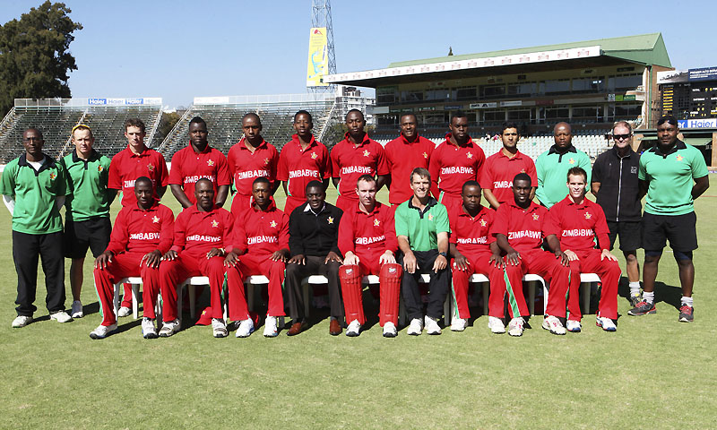 Players and coaching staff of Zimbabwe's cricket team pose for a group photo before a match against Pakistan on the first day of their one day international series in Harare, Zimbabwe, Tuesday, Aug. 27, 2013. Pakistan is in Zimbabwe for a month-long tour which will see them playing ODIs and Test matches against the host. — Photo by AP