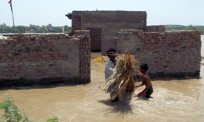 Flood affected people trying to salvage their belongings in the flood hit area at Sehreshi Nager Qasmabad Kotri Bridge. – Photo by INP