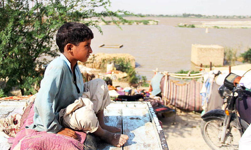 Residents of Katcha area of the River Indus are seen sitting in the open air, as their houses are submerged due to floodwater. – Online photo