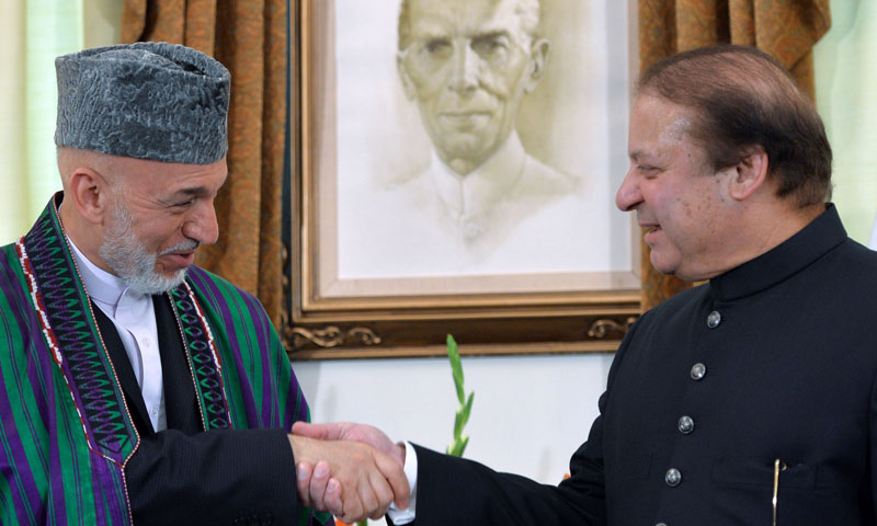 Pakistani Prime Minister Nawaz Sharif (R) shakes hands with Afghan President Hamid Karzai at the Prime Minister House in Islamabad on August 26, 2013. —AFP Photo