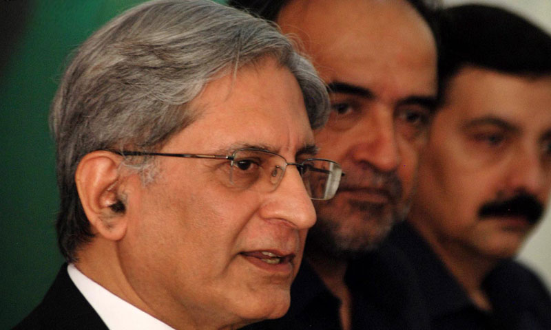 PPP leader Aitzaz Ahsan addressing a press conference along with former federal minister Qamaz Zaman Kaira at People's Secretariat. — Online photo/File