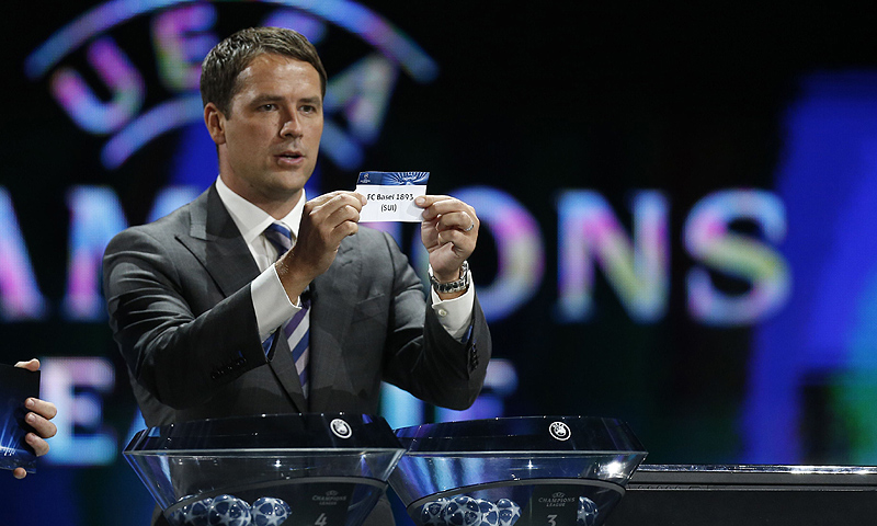 "Former English football player Michael Owen shows a paper reading ""FC Basel 1893"" as he proceeds to the draw of the UEFA 2013/2014 Champions League group stage. -Photo by AFP"