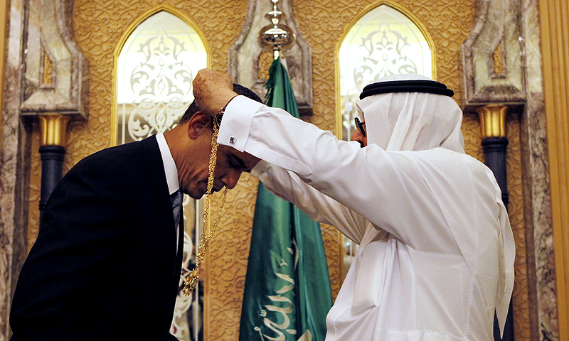In this June 3, 2009 file photo, President Barack Obama receives a gift of a gold necklace called the King Abdul Aziz Order of Merit, the country's highest honor, from Saudi King Abdullah at the start of their bilateral meeting at the King's Farm in Riyadh, Saudi Arabia. -Photo by AP