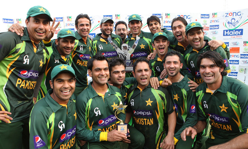 Pakistan cricket team players pose with the trophy after they beat Zimbabwe by 108 runs during their one day international against Zimbabwe in Harare, Saturday, Aug, 31, 2013. – AP Photo