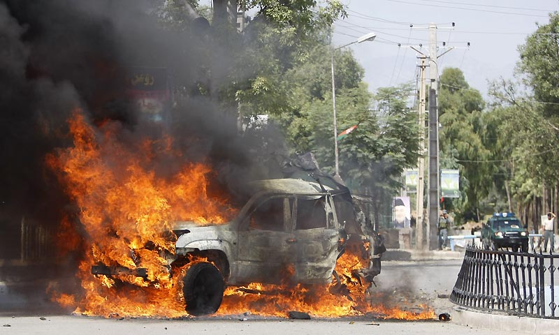 A vehicle burns at the site of a blast in Jalalabad province September 1, 2013. — Photo by Reuters
