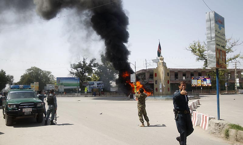 Afghan policemen stand at the site of a blast in Jalalabad province September 1, 2013. — Photo by Reuters