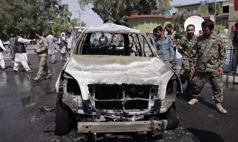 Afghan security forces investigate the scene of an explosion in front of Governor House in Jalalabad east of Kabul, Afghanistan, Sunday, Sept 1, 2013. — Photo by AP