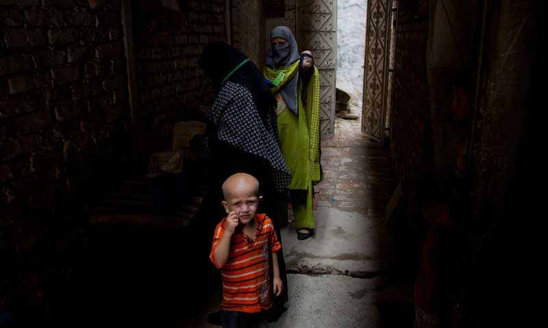 In this Aug 27, 2013 photo, health workers visit Rawalpindi slums to immunise children against polio in Pakistan. — Photo by AP