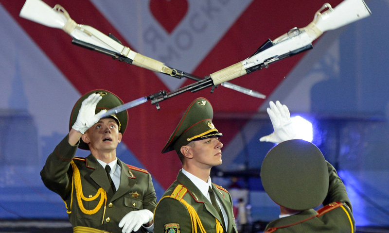 Honor guards perform during the Spasskaya Tower international military and music Festival on the Red Square in Moscow on September 1, 2013. The festival is held from September 1 to 8.
