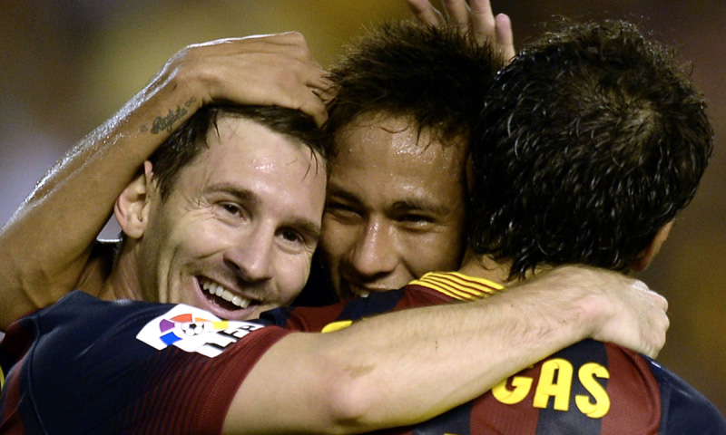 Barcelona's Argentinian forward Lionel Messi (Left), Barcelona's Brazilian forward Neymar da Silva Santos (Centre) and Barcelona's midfielder Cesc Fabregas (Right) celebrate after a goal during the Spanish league football match Valencia CF vs FC Barcelona at the Mestalla stadium in Valencia on September 1, 2013.