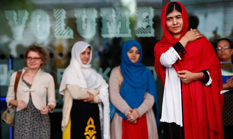 Malala Yousafzai, reacts after speaking at the opening of Birmingham Library. - Photo by Reuters