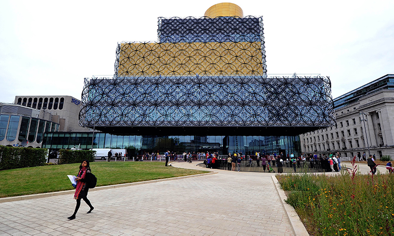 People gather outside The Library of Birmingham on its opening day in Birmingham central England. - Photo by AFP