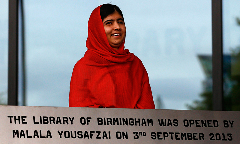Malala Yousafzai smiles after opening Birmingham Library. - Photo by Reuters