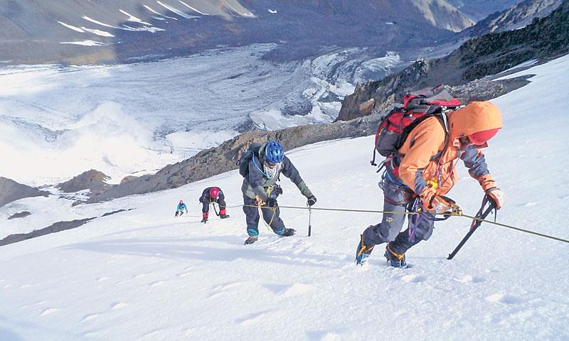 Young Pakistani mountaineers climbing Koksil V summit.