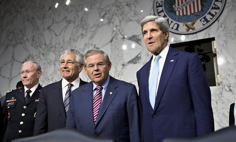 Senate Foreign Relations Chairman Robert Menendez, D-N.J., second from right, stands with, from left, Joint Chiefs Chairman Gen. Martin Dempsey, Defense Secretary Chuck Hagel, and Secretary of State John Kerry, on Capitol Hill in Washington, Tuesday, Sept. 3, 2013, prior to the start of the committee's hearing on President Barack Obama's request for congressional authorization for military intervention in Syria.  — Photo by AP
