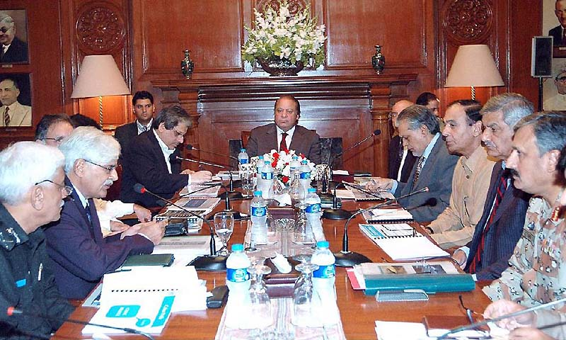 Prime MInister Nawaz Sharif presiding over a meeting on Karachi's law and order situation at the Governor House. — Photo by APP
