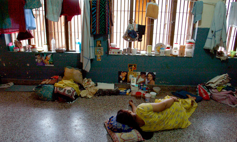 An in-law accused of dowry crimes sleeps at a communal cell in Tihar Jail's dowry wing, in Asia's largest prison in New Delhi, India. — Photo by AP