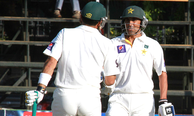 Pakistan batsman Younis Khan, right, shakes hands with fellow batsman Misbah-ul-Haq on the third day of the first test match against Zimbabwe at Harare Sports Club in Harare, Thursday, Sept, 5, 2013. – AP Photo