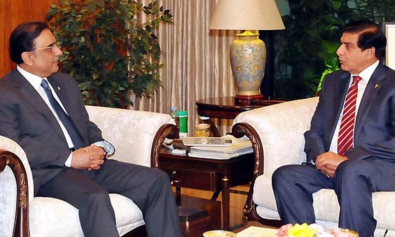 President Asif Ali Zardari in a meeting with Raja Pervez Ashraf. — File photo by INP