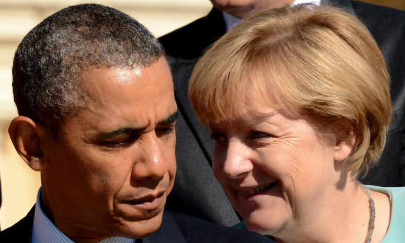 US President Barack Obama (Left) stands next to Germany's Chancellor Angela Merkel for pictures. –Photo by AFP