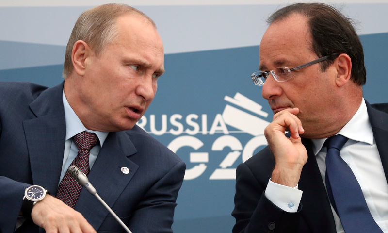 Russia's President Vladimir Putin (Left) speaks with French President Francois Hollande. –Photo by  AP