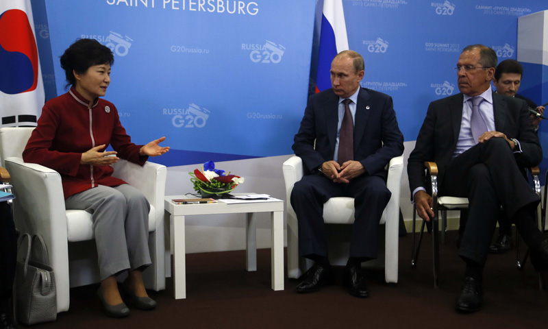 Russia's President Vladimir Putin (Center) and Russian Foreign Minister Sergei Lavrov listen to South Korea's President Park Geun-Hye (Left) during a bilateral meeting. –Photo by AFP