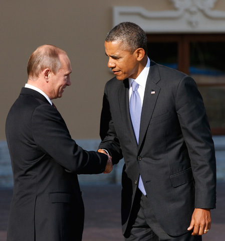 U.S. President Barack Obama, right, shakes hands with Russia's President Vladimir Putin during arrivals for the G-20 summit. –Photo by AP