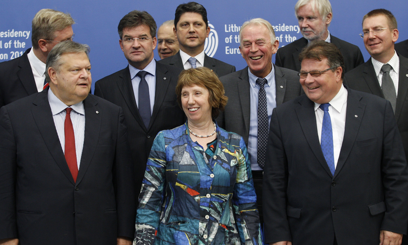 European Union Foreign Policy Chief Catherine Ashton, first row center, Lithuania's Minister of Foreign Affairs Linas Linkevicius, first row right, and Greece's Deputy Prime Minister Evangelos Venizelos, first row left, smile during the Informal Meeting of EU Ministers for Foreign Affairs in the National Art Gallery in Vilnius, Lithuania, Friday, Sept. 6, 2013. — Photo by AP